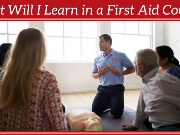 Instructor teaching first aid to a group